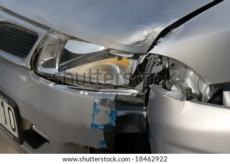 silver car wreck outdoor - stock photo