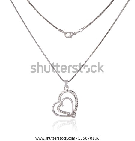Silver chain and pendant in the shape of heart - stock photo