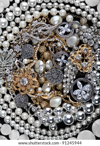 Silver chains, bracelets, pearl, necklaces and rings, jewelry - stock photo
