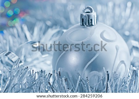 Silver Christmas ball and garland. Greeting card with space for text - stock photo