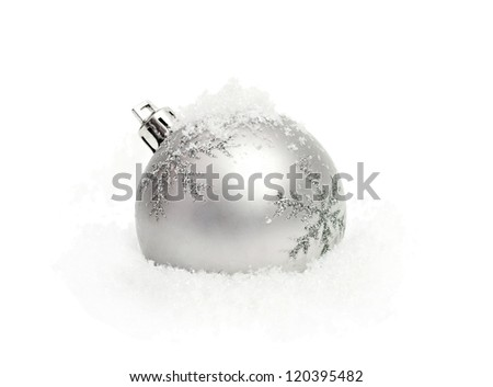 silver christmas ball with snow isolated on white - stock photo