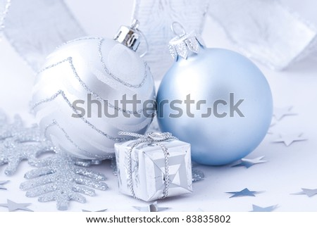Silver christmas balls an gift on white background - stock photo