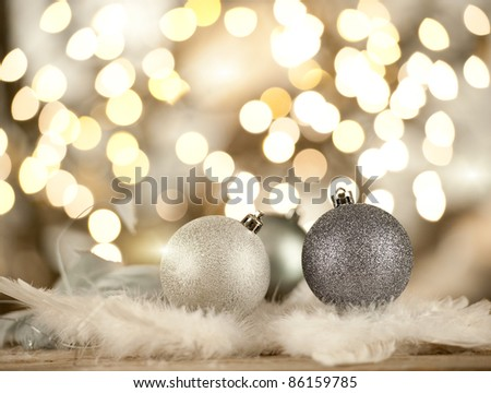 silver christmas balls on a blurred lights background - stock photo
