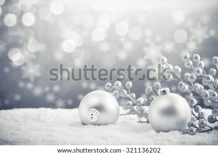 Silver Christmas balls on shiny background - stock photo