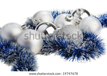 Silver Christmas balls surrounded by blue tinsel