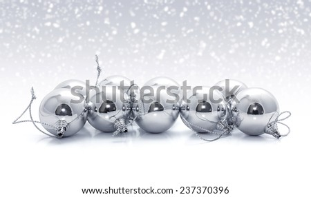 Silver christmas balls with snow background - stock photo