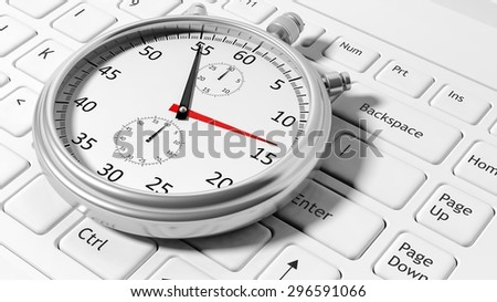 Silver chronometer white laptop keyboard - stock photo