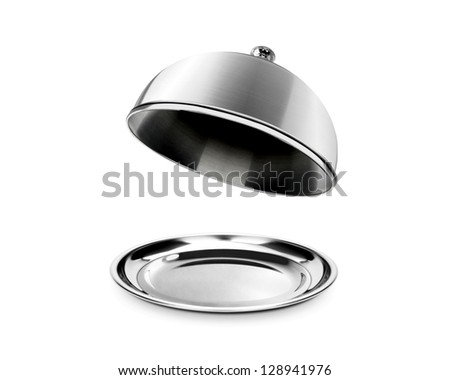 Silver cloche and platter with open lid - stock photo