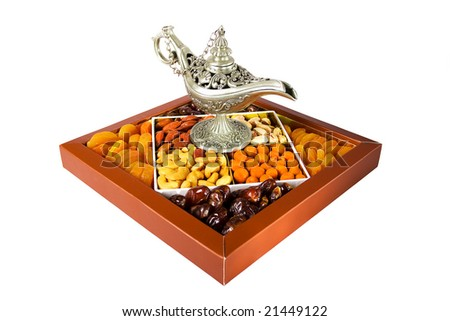 silver coffeepot and oriental sweets isolated on the white background