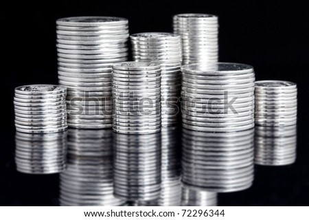 silver coin stack on black - stock photo