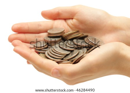 Silver coins in hands isolated on white background - stock photo