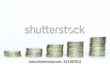 silver coins stack isolated increasing / stable money investment or saving - stock photo