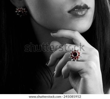 Silver collection of ring and earrings with garnets - stock photo