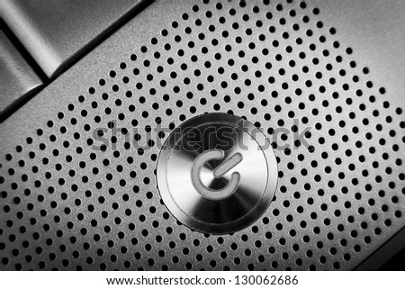 silver color  power button macro closeup  with holes grid arround - stock photo