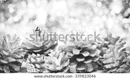 silver cones christmas decoration and snowfall