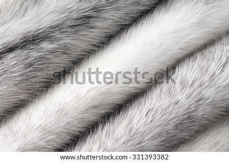 Silver cross mink fur texture macro background  - stock photo