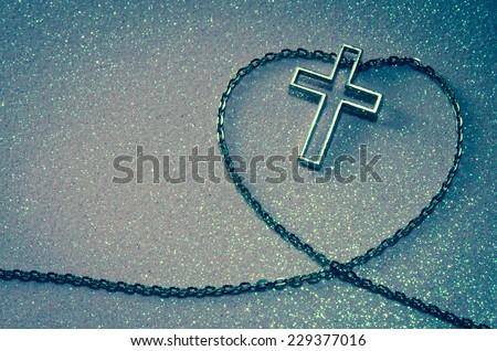 silver cross symbol in love shape image - stock photo