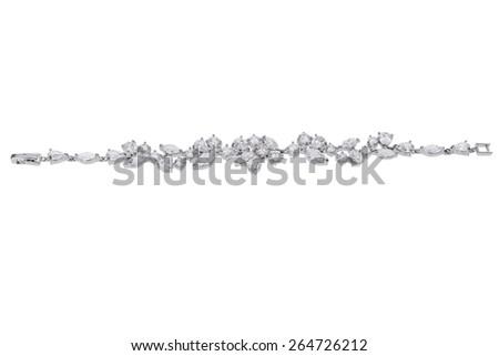 Silver diamond bracelet on white background - stock photo