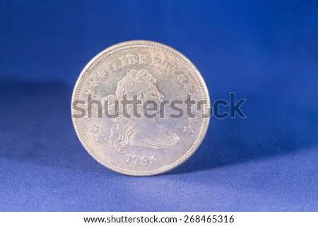 Silver dollar coin with Liberty on reverse - stock photo