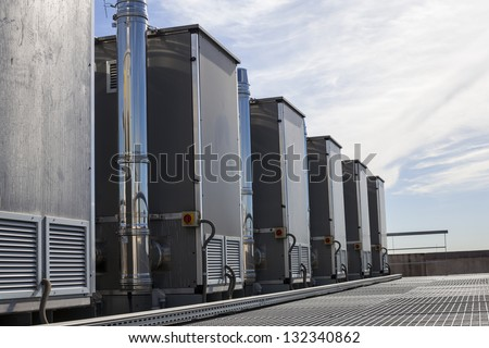 Silver ducts from the air conditioning system of an industrial building - stock photo
