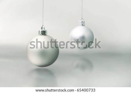 silver dull christmas ball on grey background - stock photo