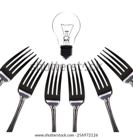 Silver fork with light bulb, eating idea - stock photo