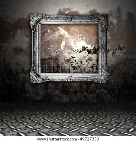 silver frame in a dark grungy room - stock photo