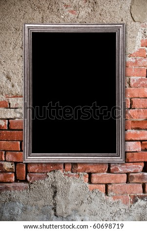 Silver frame on a old bricks wall background