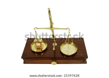 Silver fun, Measuring time passing with a clock, Brass and wood Scale used to weigh out small items - stock photo