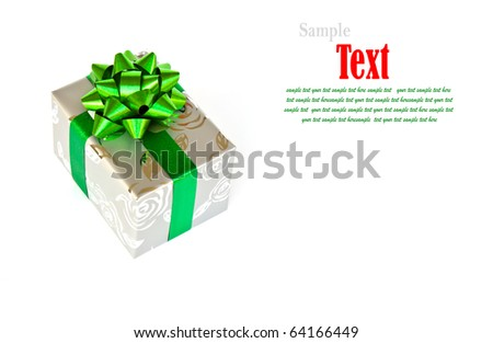 Silver gift box decorated with green ribbon isolated on white background. - stock photo