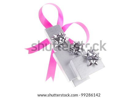 silver gift box with pink bow isolated over white background - stock photo