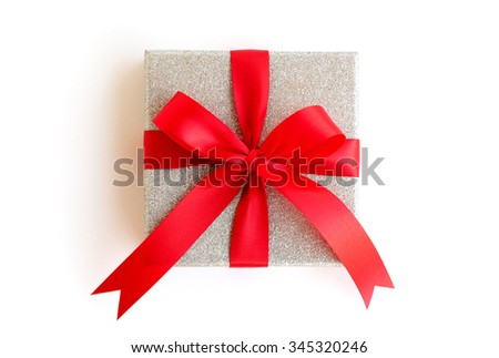 Silver gift box with red ribbon on white background with clipping path included - stock photo
