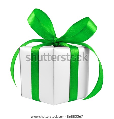 Silver gift wrapped present with green satin bow isolated on white - stock photo