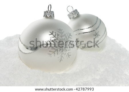 Silver glass Christmas balls on snow background. - stock photo