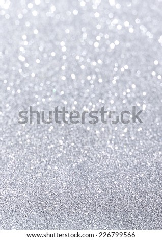 silver glitter background slipping in and out of focus - stock photo
