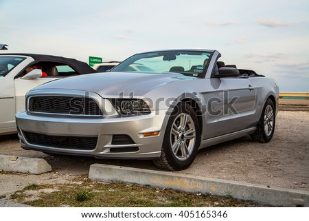 Silver grey Ford Mustang GT convertible parked on the side of the street on its way to Miami from Key West - stock photo