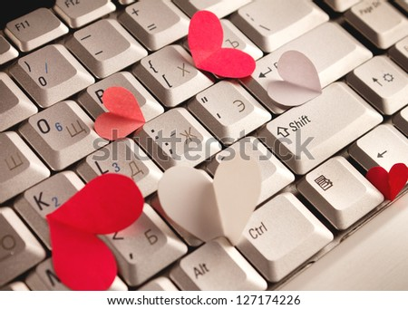 silver grey keyboard with red heart for valentines day. - stock photo