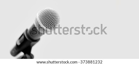 Silver handheld ball head microphone on white background