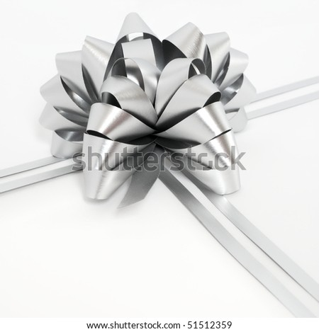 Silver holiday cockade and strings on white background - stock photo
