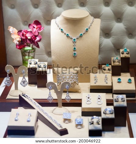 silver jewelry at showcase of jewelry store  - stock photo
