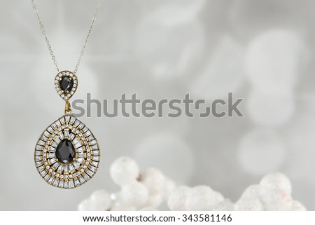 Silver jewelry chain with pendant - stock photo