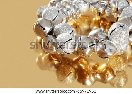 silver jingle bells with gold reflection shallow DOF - stock photo