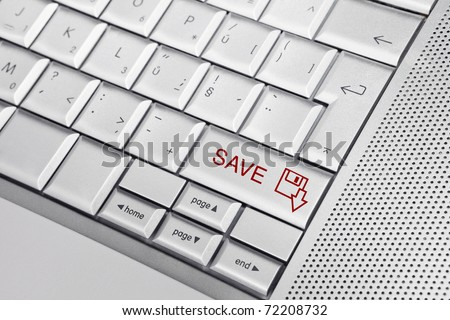 Silver keyboard with SAVE icon and SAVE text on keys. Don't forget to save your work.