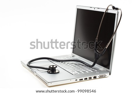 silver laptop diagnosis with black stethoscope  isolated on white background - stock photo