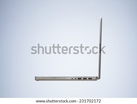Silver Laptop isolated on beautiful Studio Background. Side View with Copy Space for Text or Image - stock photo