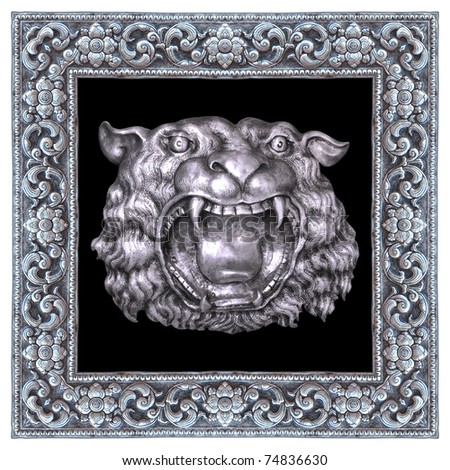 Silver lion and silver frame handmade in a Thai temple. - stock photo