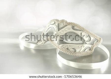 silver mask and ribbon  - stock photo