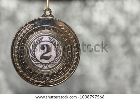 Silver medal on a white background