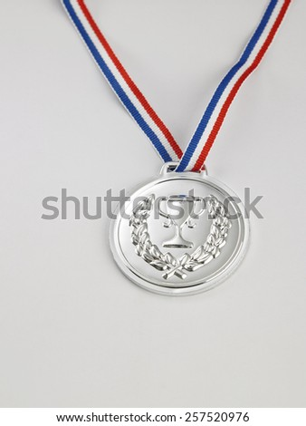 silver medal on the white background - stock photo