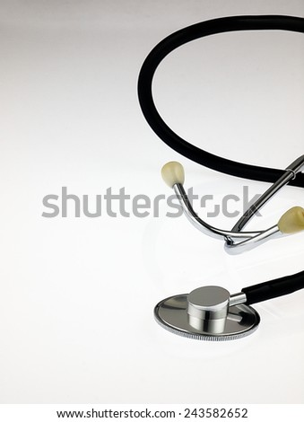 Silver medical stethoscope. Seen up close with the background out of focus.